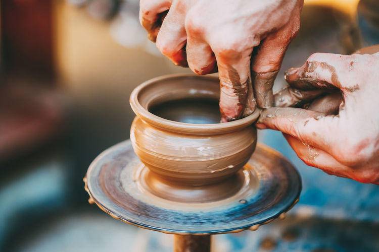 Pottery Craft Wheel Ceramic Clay Potter Human Hand Vase Art Artist Bowl Brown Ceramic Craft Creative Culture Design Finger Hand Handmade Handwork Hobby Idea Made Pot Potter Sculptor Shape Skill  Thumb Traditional Ware Wheel Work Workshop