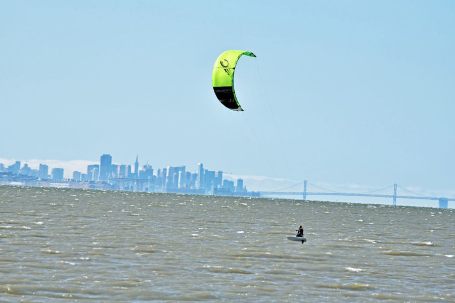 Kiteboarding In San Mateo 9 San Francisco Bay San Francisco Skyline Bay Bridge Kite Surfing Kitesurfer Colorful Sails Aquatic Sports Fog Water Marine Layer Wind Power Gusty Wind Sail Power Bridge Span Bridge Towers Water Sports Foggy Day Enjoying Life