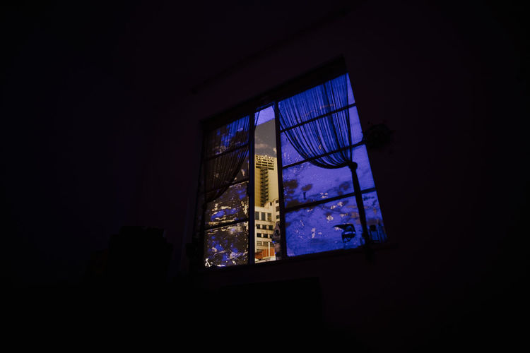 Low angle view of illuminated window in building