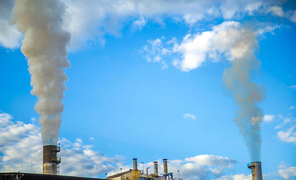 Destillery Air Pollution Alcohol Atmospheric Building Exterior Built Structure Cloud - Sky Day Ecosystem  Emitting Environment Environmental Damage Environmental Issues Factory Fumes Industry Low Angle View Nature No People Outdoors Poisonous Pollution Sky Smoke Smoke - Physical Structure Smoke Stack Sugar Cane