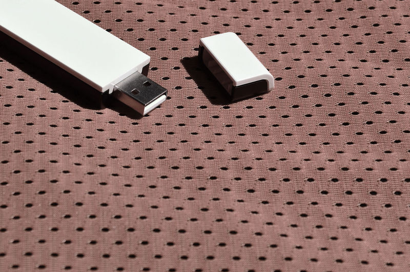 High angle view of usb stick on fabric