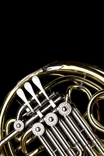 Music Instrument French Horn, French horn Isolated on black Musical Instrument Music Metal Black Background Brass Brass Instrument  Studio Shot Shiny Arts Culture And Entertainment Gold Colored Indoors  Copy Space Cut Out No People Single Object Wind Instrument Close-up Classical Music Trumpet Silver Colored Marching Band