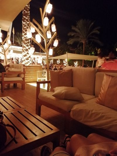 Empty chairs and table in restaurant at night