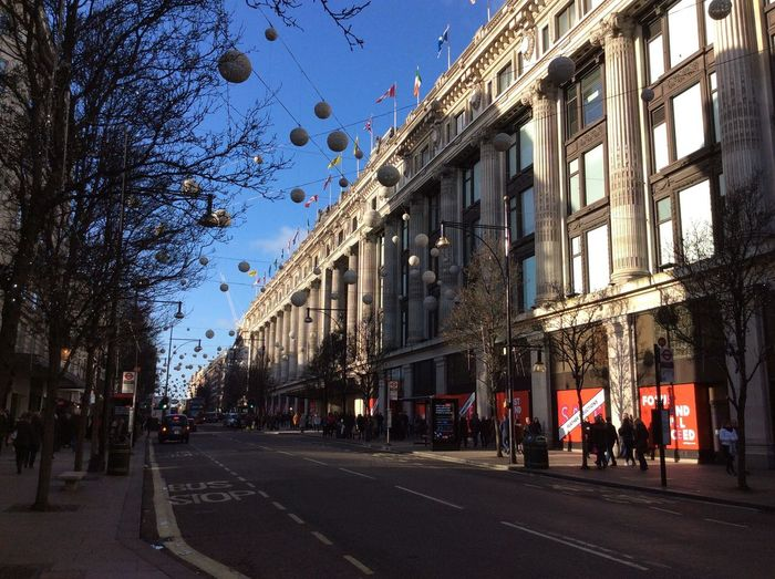 London Oxfordstreet Architecture Building Building Exterior Built Structure City City Life City Street Day Group Of People Incidental People Mode Of Transportation Nature Outdoors Plant Residential District Road Sky Street Transportation Tree