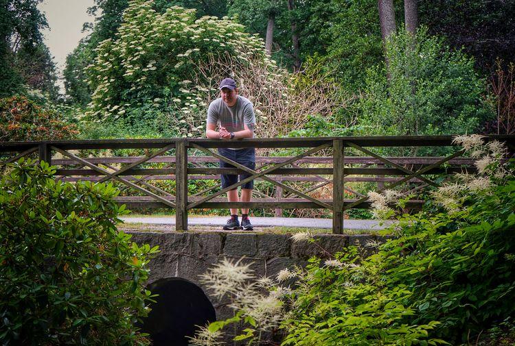 Man sitting on footbridge