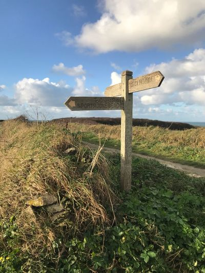 Cornwall Walks Where To Go Cloud - Sky Field Nature Landscape Grass Tranquil Scene Outdoors Wood - Material Rural Scene Walking Routes Coastal Landscape Sign Directional Sign Text Polly Joke Porth Joke