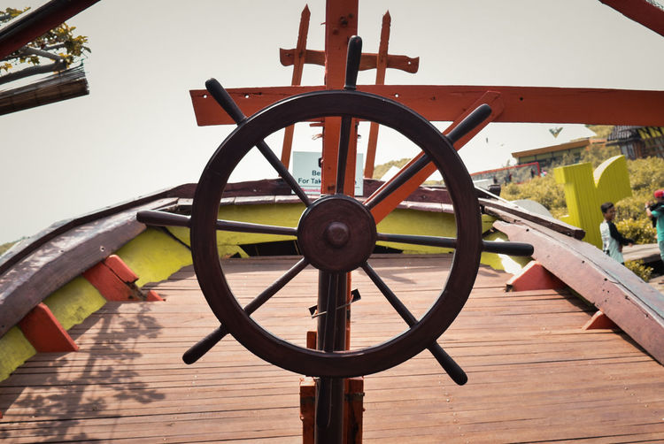 Wheel Transportation The Past History Wood - Material No People Architecture Water Close-up Geometric Shape Shape Day Outdoors Nature Cannon Circle Helm Lake Metal Wagon Wheel