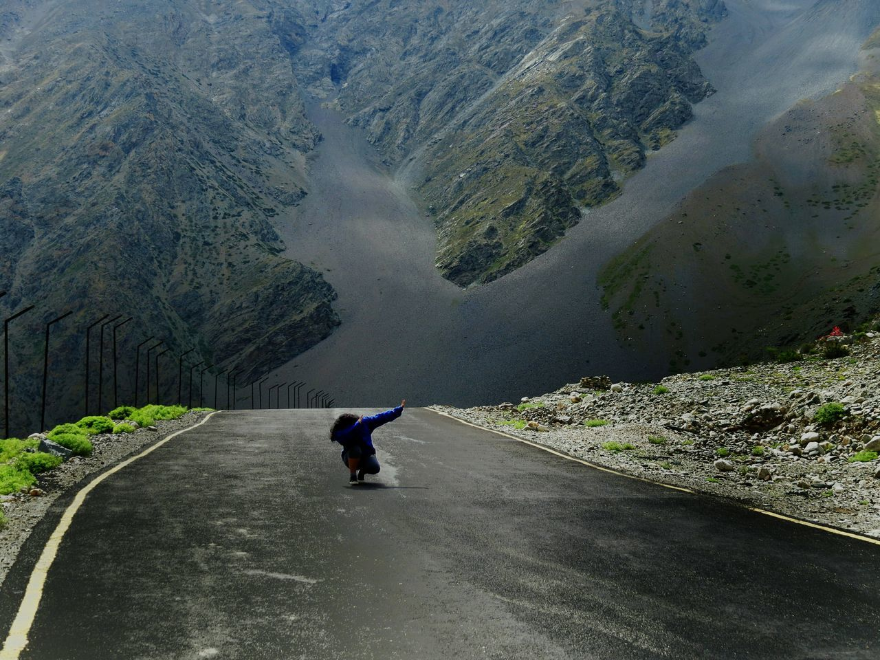 REAR VIEW OF WOMAN ON ROAD