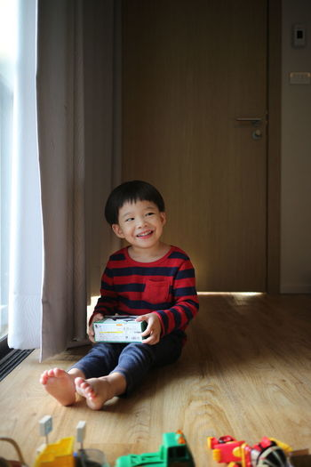 Smiling Boy Sitting At Home
