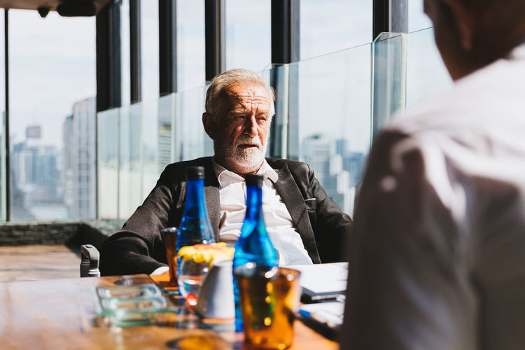 Businessman and colleague sitting at table