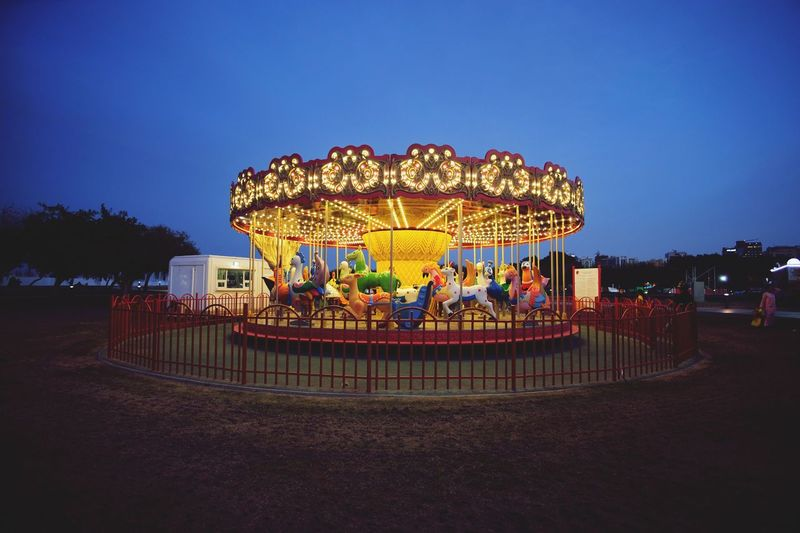 Carousel Amusement Park Ride Amusement Park Carousel Illuminated Sky Arts Culture And Entertainment Night Merry-go-round Nature Outdoors Leisure Activity Dusk Clear Sky Enjoyment No People Architecture Lighting Equipment Glowing Animal Representation Recreational Pursuit