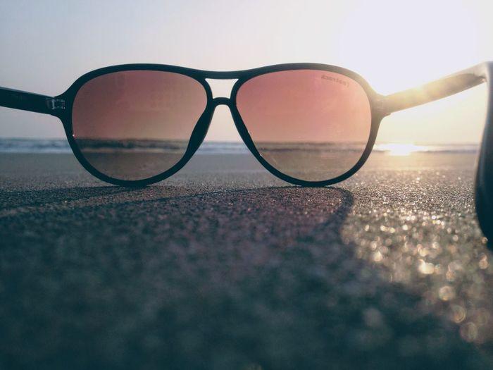 Sunglasses Eyeglasses  Vision Eyewear Surface Level Outdoors No People Protection Eyesight Beach Sunset Nature Day Glasses Close-up Sea Sky Water
