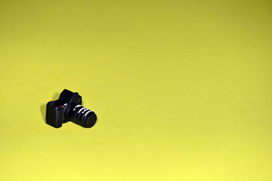 Black camera - USB flash on yellow background. Camera Flash Memory USB Flash Drive Backround Black Close-up Computer Data Film Industry Gift Indoors  Indoors  No People Photo Camera Photography Themes Storage Studio Shot Technology Yellow