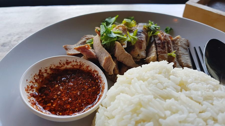 Sliced BBQ pork with easy thai stye paste and rice Esarn Food Esarn Pork Grill Grilled Pork Grill BBQ Jasmine Rice Steam Rice Cooked Rice Pasley Thai Food Traditional Thai Food EyeEm Selects Comfort Food Close-up Rice - Food Staple Served Sauce Dish