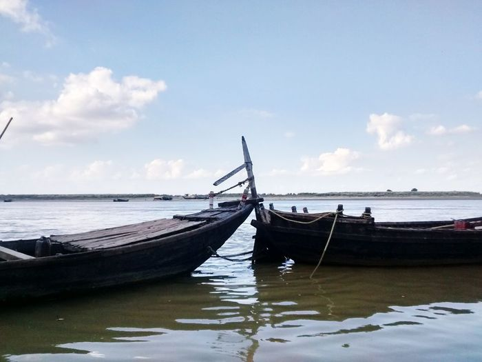 Side view of boats moored in calm sea