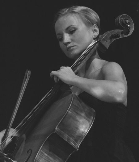 Polonia String Quartet Adult Arts Culture And Entertainment Black Background Cellist Cellist Cello Classical Music Concentration Leisure Activity Music Musical Instrument Musical Instrument String Musician One Person People Performance Playing Real People Skill  Young Adult