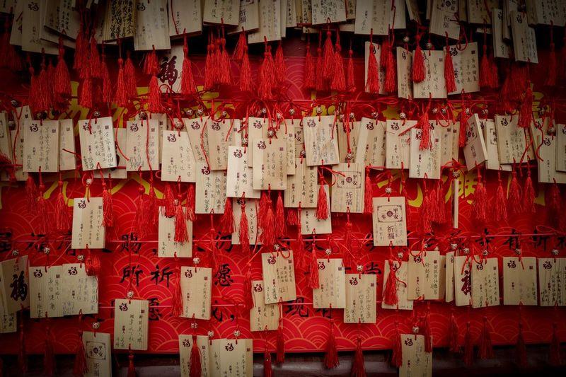 Full frame shot of praying flags hanging outside temple