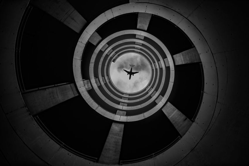 🌀 Spiral Staircase Spiral Parking Garage Parking Lot Parking Airplane Airport Blackandwhite Photography Black & White Blackandwhite Black Architecture Day Built Structure Indoors