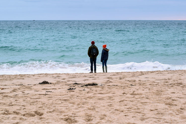 admiring nature People Togetherness Holiday Season Tourists Two People Looking Out To The Sea Nature Porthcurno England Britains Coastline Water Wave Sea Bonding Togetherness Friendship Beach Full Length Sand Shore Sandy Beach Horizon Over Water Seaside Calm Ocean