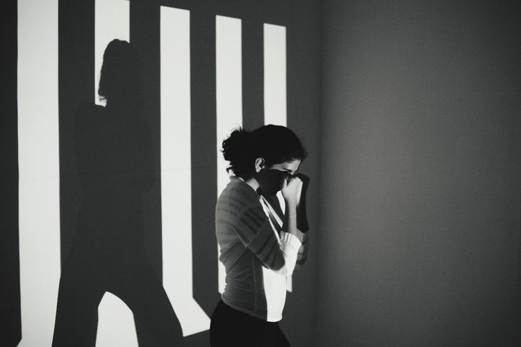 Woman Practicing Against Wall