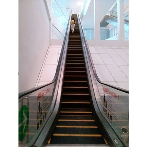 "The Escalator is working, but Sharon was so impatient that she ran all the way to the top and called it ""practicing"" for Kltowerthon2014 Kltowerthon tomorrow lol! Crewlife klia2"