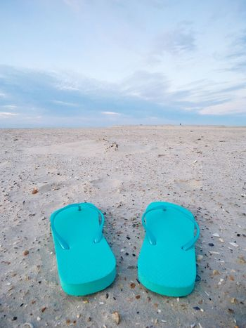 Flipflops at the beach Flipflops Flip-flop Norderney North Sea Germany Backgrounds Holiday Vacation Summer Sandal Blue Land Sky Sand Blue Beach Cloud - Sky Nature Day No People Absence Tranquility Sea Outdoors Shoe Pair