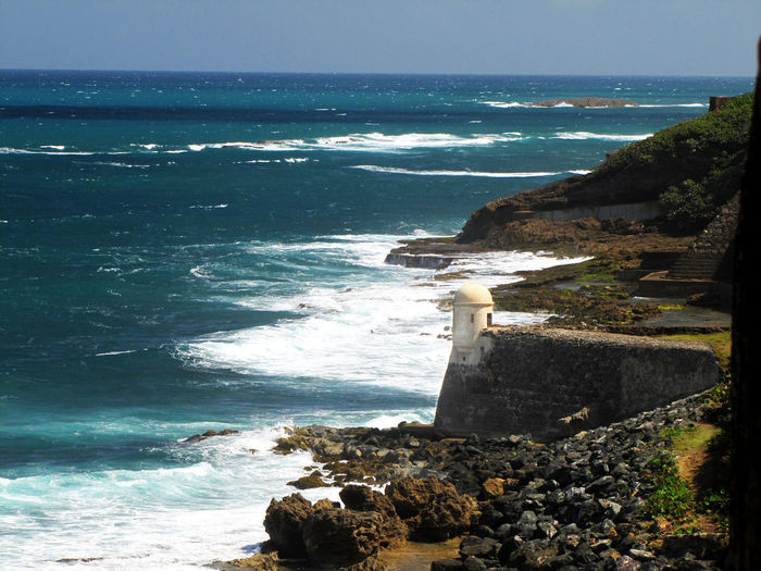 Seashore on the outside of San Cristobal castle in San Juan, Puerto Rico Sea Water Horizon Over Water Horizon Land Solid Beach Rock Scenics - Nature Beauty In Nature Wave Rock - Object Sky Day Nature No People Aquatic Sport Architecture Motion Outdoors