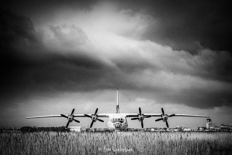 Antonov plane A12 Airplane Antonov A12 Beauty In Nature Blackandwhite Cloud - Sky Cloudy Day Environmental Conservation Eye4photography  EyeEm Best Edits EyeEm Best Shots EyeEm Gallery EyeEmBestPics Field Grass Landscape Nature No People Outdoors Overcast Rural Scene Sky Tranquility