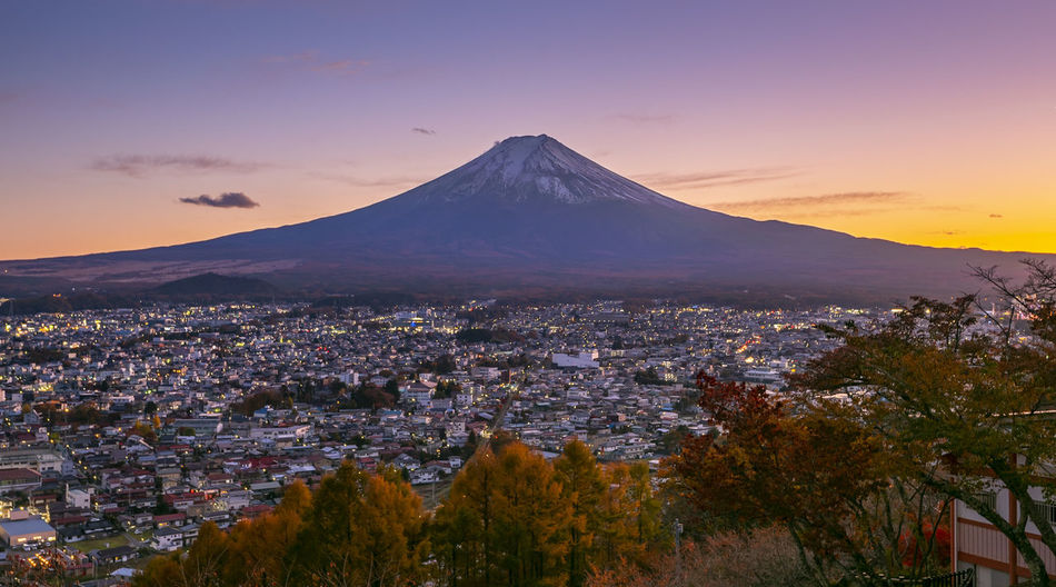 Aerial view of city against sky during sunset at fuji mount,japan