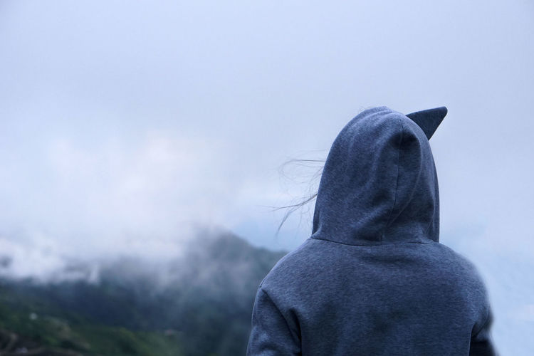 Woman looking at fog and natural view in front