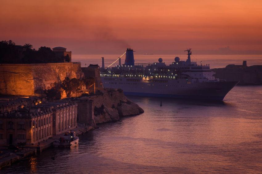 Cruise ship enters Grand Harbour (Malta) just before sunrise. Cruise Ship Malta Mediterranean  Cloud - Sky Cruise Dusk Grand Harbour Illuminated Nautical Vessel Portrait Sea Sky Transportation Water Waterfront