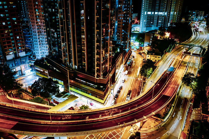 High angle view of city street and buildings at night