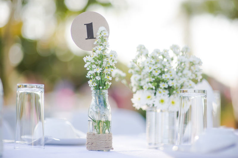 White flowers in glass vase on table