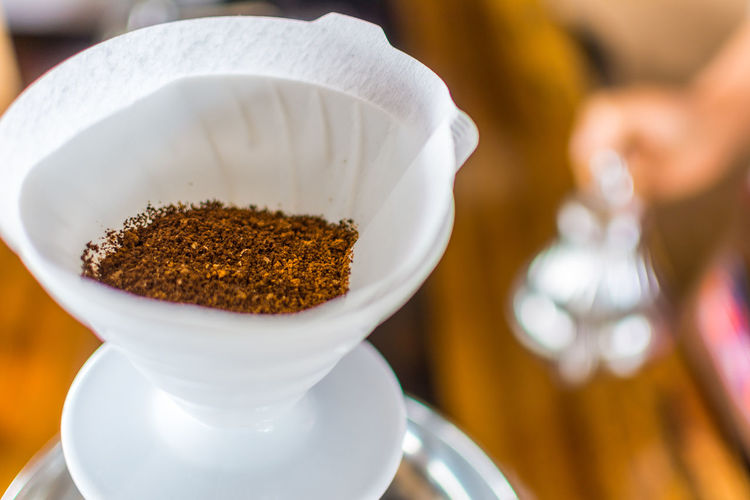 Close-Up Of Ground Coffee In Cup