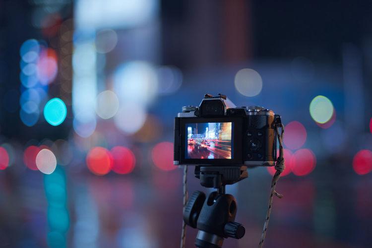 Close-up of camera at night