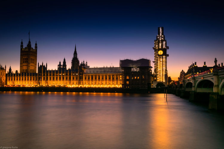 Palace of Westminster he Palace of Westminster is the meeting place of the House of Commons and the House of Lords, the two houses of the Parliament of the United Kingdom. Cityscape City Life City Capital City LONDON❤ Palace River View Riverbank Riverscape Architecture Travel Destinations Building Exterior Built Structure Illuminated Clock Tower Reflection Government Gothic Style Building Sky Water River Tower Night