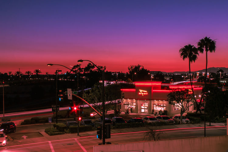 Retro Architecture Building Exterior Built Structure Car City Cityscape Illuminated Motor Vehicle Nature Night No People Outdoors Palm Tree Plant Road Sign Sky Street Sunset Transportation Tree Tropical Climate