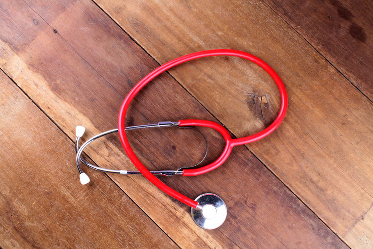 Directly Above Shot Of Red Stethoscope On Table