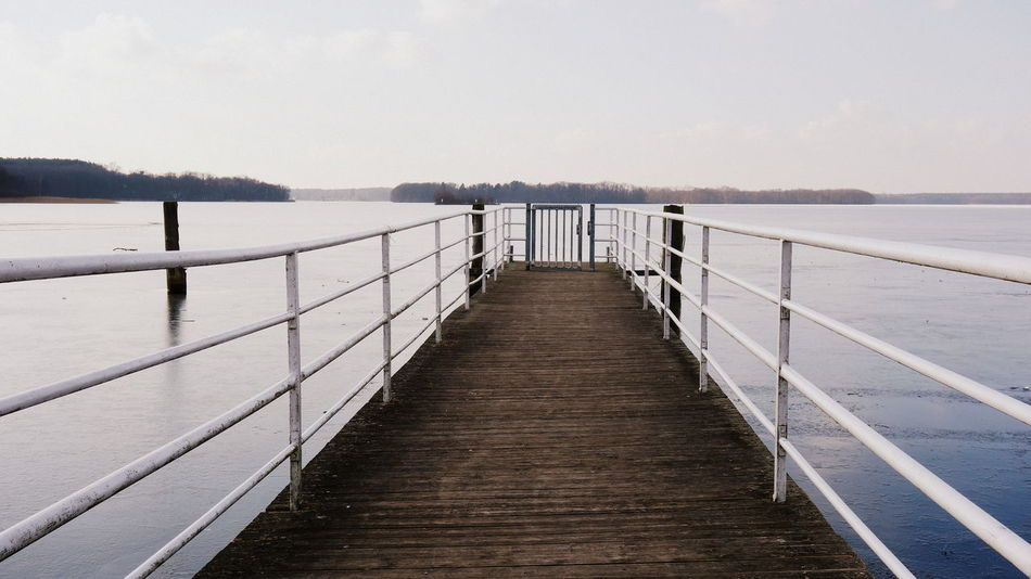 Frozen Ice Pier Winter Beauty In Nature Day Horizon Over Water Island Jetty Lake Side Nature No People Outdoors Pier Railing Scenics Sea Sky The Way Forward Tranquil Scene Tranquility Water Wood - Material Wood Paneling