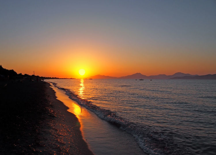 beautiful golden sunset reflected on the sea and wet beach sand in Kos Greece Twilight Beach Beauty In Nature Clear Sky Idyllic Kos Land Nature No People Non-urban Scene Orange Color Outdoors Reflection Scenics - Nature Sea Sky Sun Sunlight Sunset Tranquil Scene Tranquility Water