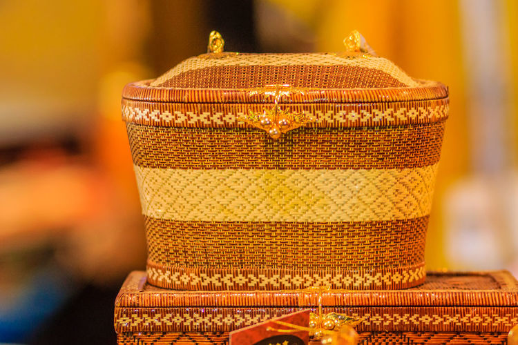 """Beautiful lady handbags and basketry that made from Lygodium (climbing fern), or """"Yan lipao"""" in Thai, the famous product from Southern Thailand for sale at night market, Bangkok. Night shot with grain Lygodium Yan Lipao Yanlipao Basketry Climbing Fern Close-up Day Focus On Foreground Gold Colored Handbag  Handbags Handbagshop Indoors  Lady Handbag Lady Handbags No People"""