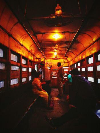 Tram tales Illuminated Person Large Group Of People Lighting Equipment Journey City Life Standing Men Memories History Noir Hometown City Life KolkataStreets Tramway Tram Vintage Mode Of Transport Transportation City Communication Art Glow Kolkatadiaries Kolkatainstagrammers