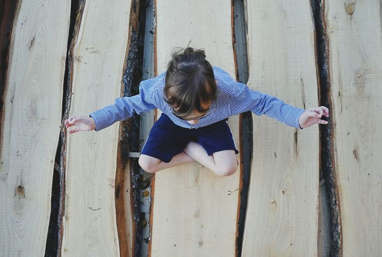Girl doing yoga on logs