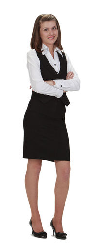 Young woman with her arms crossed looking at the camera. Looking At Camera Studio Shot Full Length White Background Portrait Cut Out Smiling One Person Standing Businesswoman Business Person Young Adult Happiness Front View Adult Woman Young Woman Young Woman Smiling