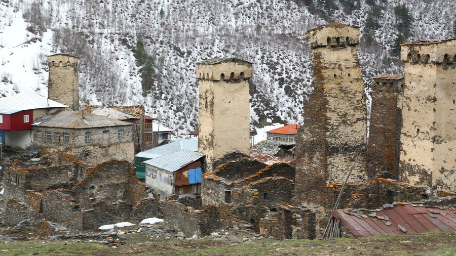 Georgia Mestia/town In Svaneti/Georgia Built Structure Architecture Day Building Exterior Nature Building No People Outdoors Abandoned Old Damaged History Group Of Animals Weathered Animal Themes Run-down Wall - Building Feature Obsolete House Animal Collapsing Ruined