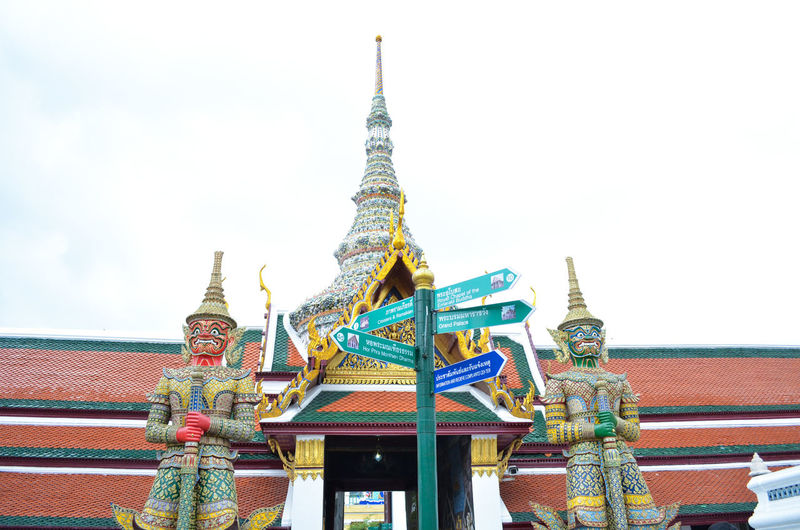 Architectural Feature Architecture Building Exterior Built Structure Culture Day Decoration Eaves Famous Place Giant At Wat Phra Keaw Temple Gilded High Section Low Angle View Multi Colored Ornate Outdoors Pagoda Place Of Worship Bangkok Spire  Stupa Temple - Building Traditional Travel Destinations Thailand