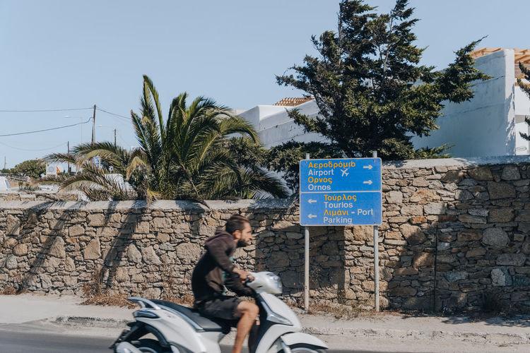 Man riding horse cart on street
