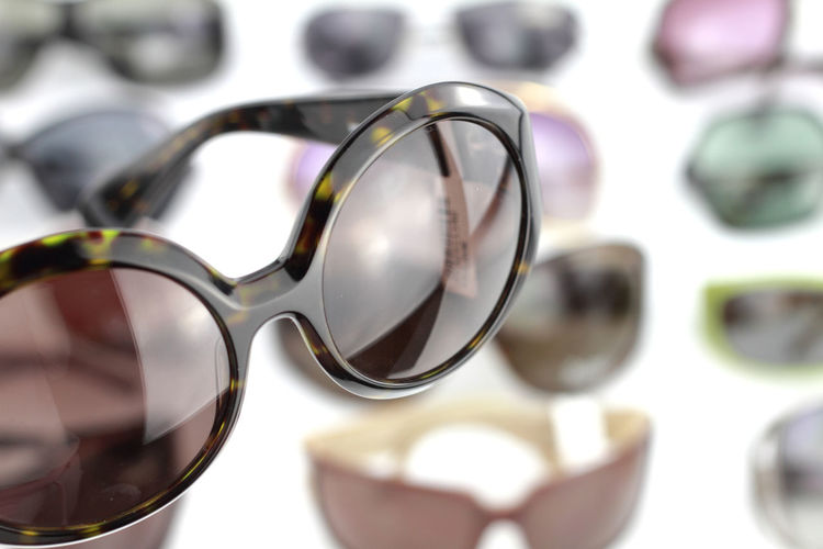 Close-up Eyeglasses  Eyesight Eyewear Fashion Focus On Foreground Glass - Material Glasses Indoors  Luxury No People Personal Accessory Protection Reflection Security Selective Focus Silver Colored Still Life Sunglasses Table Transparent Wealth