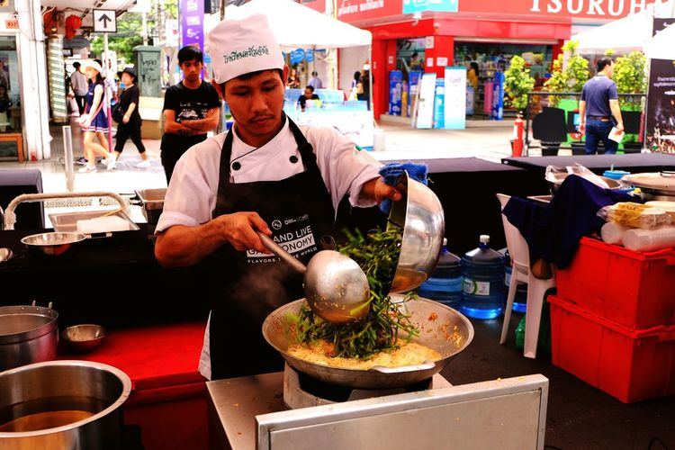 Stir-Fried Rice Noodles with Shrimp Neptunia Oleracea. Thailand Live Gastronomy. Preparing Food Preparation  Market Stall Chef Market Commercial Kitchen Market Food Photography Food Thaifoodfestival Travel Destinations Travel Outdoor Photography Outdoors People Real People One Person Food Stories Business Stories