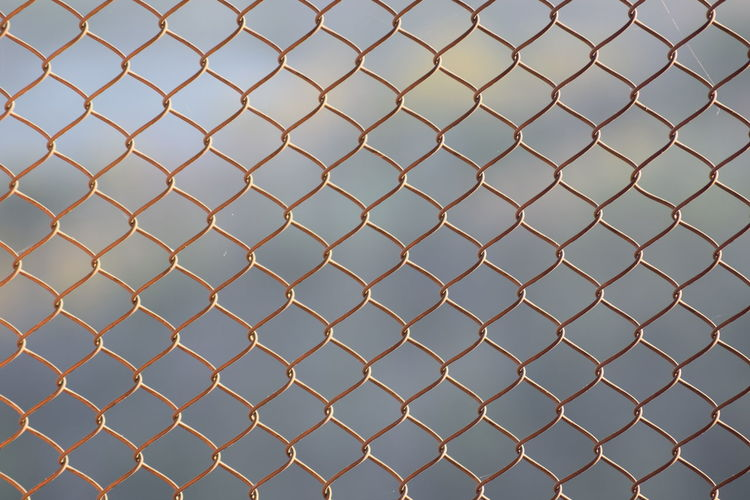 Pattern of a fence. Backgrounds Background Landscape Full Frame Backgrounds Pattern Protection Metal Safety Security Chainlink Fence Sky Crisscross